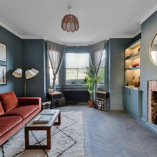 Living room - mid-sized midcentury modern dark wood floor and brown floor living room idea in London with blue walls