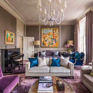 This is an example of a large classic formal open plan living room in London with brown walls, carpet, no tv and purple floors.