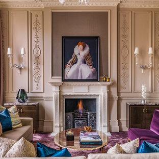 На фото: большая парадная, открытая гостиная комната в викторианском стиле с бежевыми стенами, ковровым покрытием, стандартным камином, фасадом камина из камня и фиолетовым полом без ТВ с