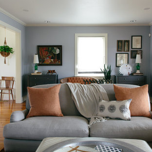Inspiration for an eclectic formal enclosed living room in New Orleans with blue walls and medium hardwood flooring.