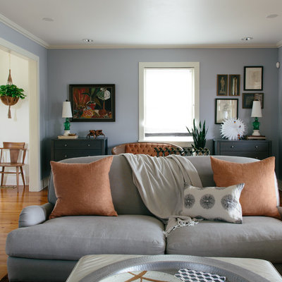 Living room - eclectic enclosed and formal medium tone wood floor living room idea in New Orleans with blue walls