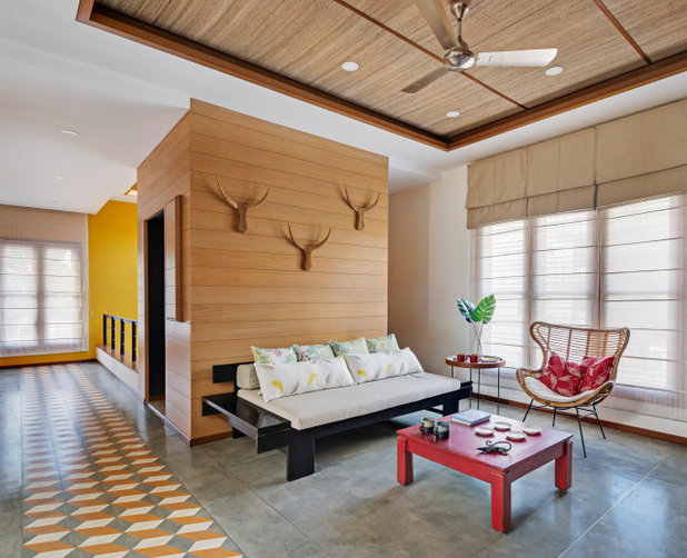 Asian Family Room by Yellow Door Architects