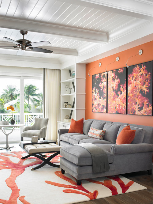 Orange Wall Living Room. Example of a transitional open concept dark wood floor living room design  in Miami with orange 70 Best Living Room Orange Walls Ideas Houzz