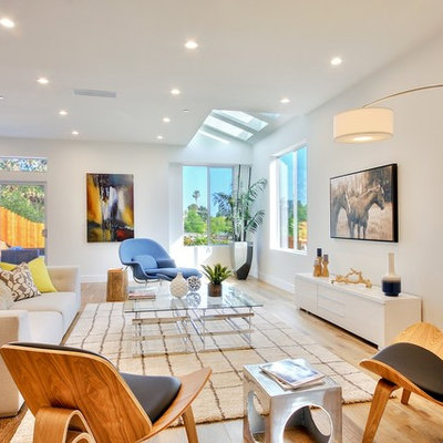 Inspiration for a contemporary formal light wood floor living room remodel in Los Angeles with white walls