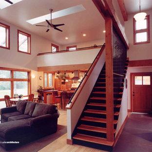 Immagine di un soggiorno design di medie dimensioni e stile loft con sala formale, pareti beige e pavimento in bambù