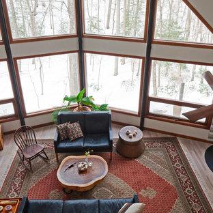 Ispirazione per un soggiorno scandinavo di medie dimensioni e stile loft con pareti bianche, stufa a legna e cornice del camino piastrellata