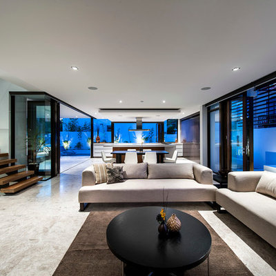 Inspiration for a large contemporary open concept beige floor living room remodel in Perth with white walls
