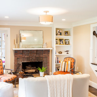 Inspiration for a small timeless dark wood floor living room remodel in Boston with brown walls, a standard fireplace and a brick fireplace