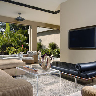 Living room - modern open concept living room idea in Orlando with beige walls and a wall-mounted tv