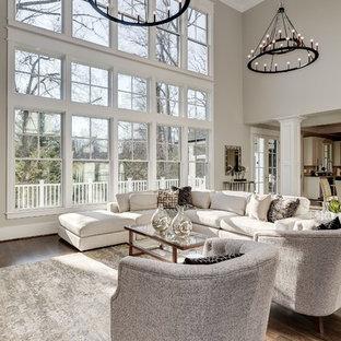 Foto de salón abierto, clásico, con paredes grises, suelo de madera oscura y suelo marrón