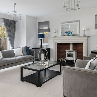 Inspiration for a large traditional formal open plan living room in Berkshire with grey walls, carpet, no tv, grey floors and a wood burning stove.