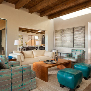Example of a large southwest formal and open concept light wood floor living room design in Albuquerque with beige walls, no fireplace and no tv
