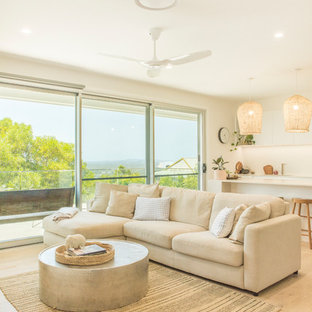 Photo of a large contemporary open concept living room in Sunshine Coast with white walls and light hardwood floors.