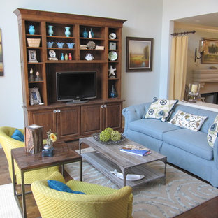Mid-sized eclectic living room photo in Atlanta with white walls and a tv stand