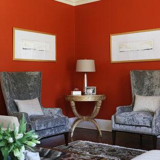 ニューヨークの中サイズのトラディショナルスタイルのおしゃれな独立型リビング (フォーマル、赤い壁、カーペット敷き、標準型暖炉、石材の暖炉まわり、テレビなし、マルチカラーの床) の写真