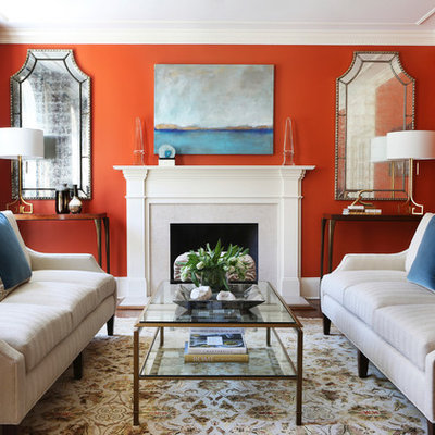 Example of a mid-sized classic formal and enclosed carpeted and multicolored floor living room design in New York with a standard fireplace, red walls, a stone fireplace and no tv