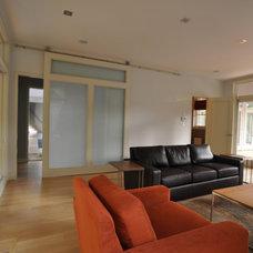 Contemporary Living Room by RAM Affiliates, LLC dba The RAM Group