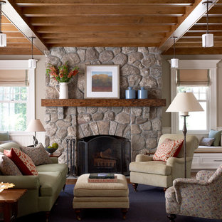 Large elegant formal and enclosed medium tone wood floor living room photo in New York with gray walls, a stone fireplace and a standard fireplace
