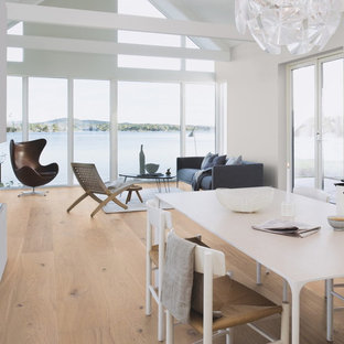 Inspiration for a mid-sized contemporary formal and open concept light wood floor living room remodel in San Francisco with white walls, no fireplace and no tv