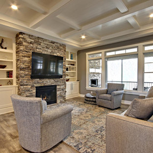 Large nautical formal open plan living room in Grand Rapids with beige walls, vinyl flooring, a standard fireplace, a stone fireplace surround, a wall mounted tv and multi-coloured floors.