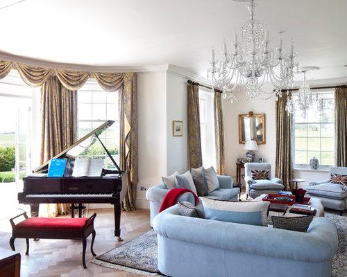 Elegant living room photo in Gloucestershire with beige floors
