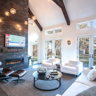 Mid-sized cottage chic open concept porcelain floor and gray floor living room photo in Boston with white walls, a standard fireplace, a tile fireplace and a wall-mounted tv