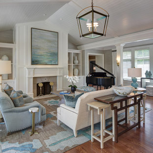 Large transitional formal and open concept medium tone wood floor living room photo in Cleveland with a standard fireplace, a stone fireplace, white walls and no tv