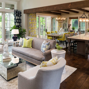 Inspiration for a large french country open concept and formal dark wood floor and brown floor living room remodel in Minneapolis with beige walls, a standard fireplace and a stone fireplace