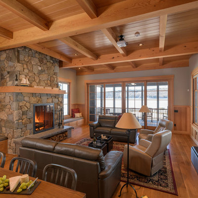 Living room - rustic formal and open concept medium tone wood floor and brown floor living room idea in Boston with green walls, a standard fireplace and a stone fireplace