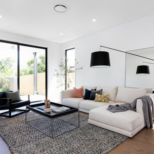 Inspiration for a large contemporary living room in Sydney with white walls, medium hardwood floors and brown floor.
