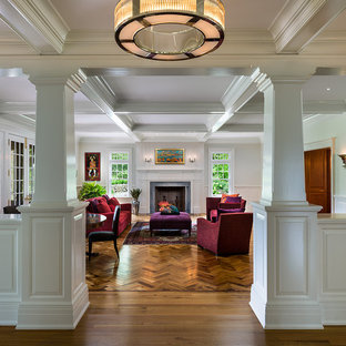 Example of a large classic formal and enclosed medium tone wood floor and brown floor living room design in Philadelphia with white walls, a standard fireplace, no tv and a wood fireplace surround