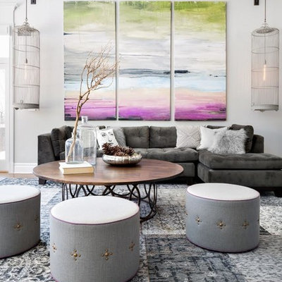 Example of a trendy living room design in New York with gray walls and no tv