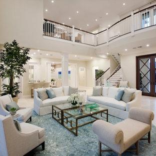 Esempio di un grande soggiorno tropicale aperto con sala formale, pareti bianche e pavimento in marmo
