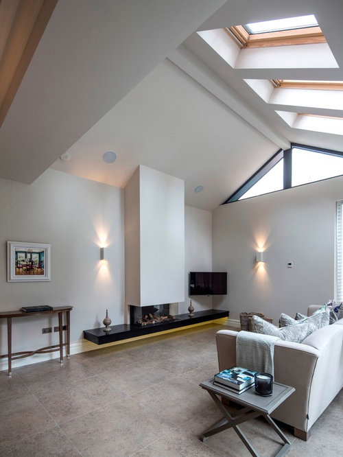 Trendy open concept living room photo in London with white walls, a ribbon  fireplace and