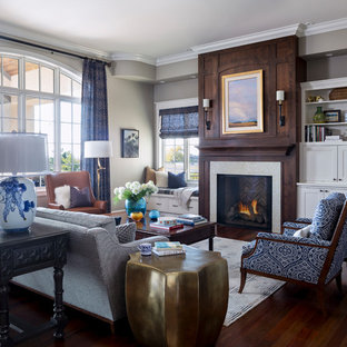 Transitional open concept dark wood floor and brown floor living room photo in Denver with gray walls and a standard fireplace
