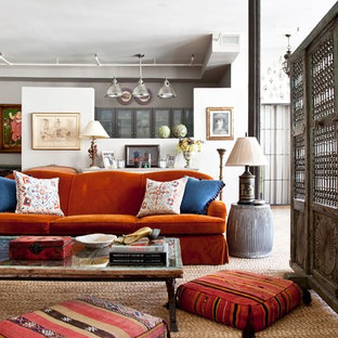 Example of an eclectic living room design in New York with white walls