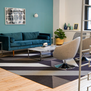 Example of a mid-sized 1950s open concept light wood floor living room design in New York with blue walls and no tv