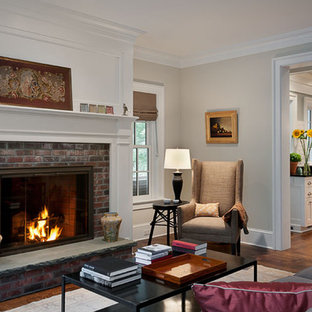 Inspiration for a traditional enclosed living room in New York with beige walls, a standard fireplace, a brick fireplace surround and no tv.