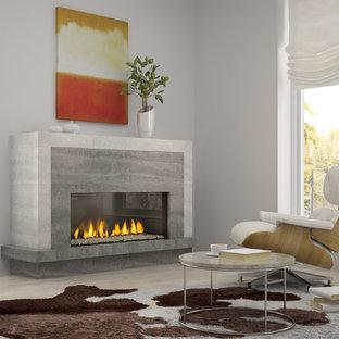 Idéer för ett mellanstort modernt allrum med öppen planlösning, med ett musikrum, grå väggar, bambugolv, en standard öppen spis och en spiselkrans i betong