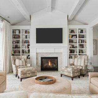 Exemple d'un salon chic avec une salle de réception, un mur blanc, moquette, une cheminée standard, un manteau de cheminée en brique, un téléviseur fixé au mur et un sol beige.