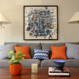 Inspiration for a transitional enclosed medium tone wood floor living room remodel in Boston with gray walls