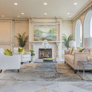 Inspiration for a large transitional formal and enclosed marble floor living room remodel in Orange County with beige walls, a standard fireplace, no tv and a tile fireplace