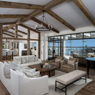 Inspiration for a large classic open plan living room in Orange County with a music area, white walls, medium hardwood flooring, no fireplace and no tv.