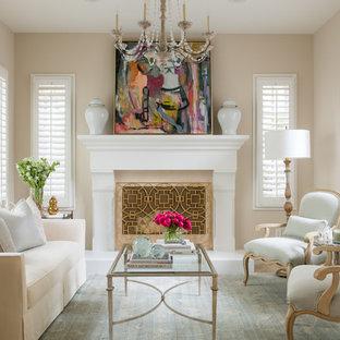 Immagine di un soggiorno chic di medie dimensioni e chiuso con pareti beige, camino classico, nessuna TV, cornice del camino in legno e sala formale