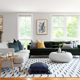 Inspiration for a coastal medium tone wood floor and brown floor living room remodel in Providence with gray walls