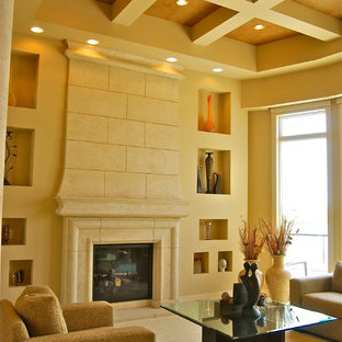 オマハのコンテンポラリースタイルのおしゃれなリビング (フォーマル、ベージュの壁、カーペット敷き、標準型暖炉、漆喰の暖炉まわり) の写真