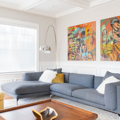 Inspiration for a contemporary formal medium tone wood floor and brown floor living room remodel in Boston with white walls