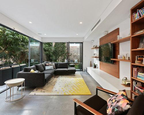Wohnzimmer Mit Betonboden Und Brauner Wandfarbe