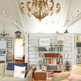 Example of a cottage chic medium tone wood floor living room library design in Detroit