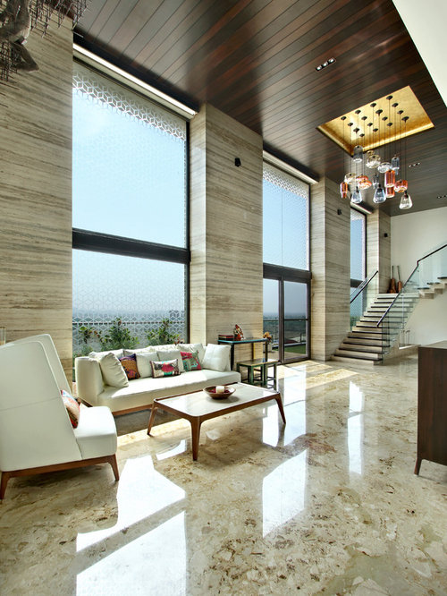 Inspiration for a large contemporary open concept marble floor living room  remodel in Other